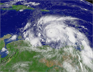 A NOAA satellite image of Hurricane Ivan taken at 3:45 pm ET on Tuesday 7th September 2004 showing the eye heading west over Grenada, with sustained winds near 220 km/h.